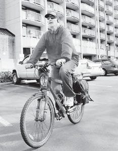 Roger Elliott bikes 5 miles each way to work in Maugansville, Md., from his apartment in Hagerstown. He has survived four strokes before he turned 40. (AP Photo/The Herald Mail)