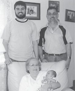 FOUR GENERATIONS — Matthan Shane Kiser celebrated his first Easter in McRoberts. He was born March 8 at the University of Kentucky Medical Center. He is the son of Megan Edwards Kiser and Shane Kiser of Irvine, and is pictured with his father, grandfather Reno Kiser, and great-grandmother Margie Kiser.