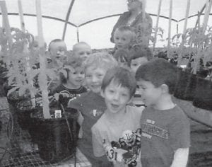 YOUNG FARMERS — Cowan Head Start students have been farming. They visited David Tyler's greenhouse at Dry Fork, and he gave them tomato plant and marigolds to plant. As soon as the freeze warning is over, the students will plant them at the school.
