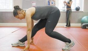 Jen Solomon, a personal trainer, demonstrates stretching in a gym in central London. Many people take it for granted that they should start their exercise routines with some stretching on the spot, perhaps hoping it will loosen them up for their work-out. Most fitness experts now agree this kind of static stretching before exercise is not just counter-productive, but potentially harmful. (AP Photo)
