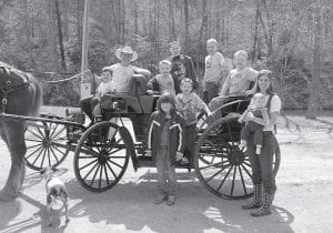 WAGON RIDE — Students and instructors gathered for a group photograph at The Stables at Creekside Glen in Partridge last week. Pictured are (front row, from left) Amber Holbrook, Leah and Anna Belle Baldwin, (second row) Mark Howard, (third row, from left) Boone Baldwin, Drew Baldwin, Thomas Cook, Alex Davis, Zach Bates, Matthew Wilder and Logan Wynn. (Photo by Sally Barto)