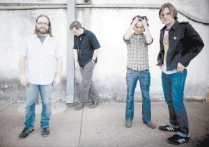 Jason Isbell is pictured second from left. Members of The 400 Unit are (from left) bass player Jimbo Hart, keyboard player Derry DeBorja, and guitarist Browan Lollar. The band will perform here Friday night.
