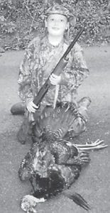 YOUNG HUNTER — Corey Sparkman, a fourth-grade student at Letcher Elementary School, killed his first turkey May 2. He is the son of Tina and Gary Sparkman of Hallie. The turkey weighed 21 pounds, and had an 11- inch beard and one-inch spurs.