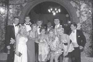 This photo provided by Mary Institute and St. Louis Country Day School (MICDS) shows Upper School students at MICDS during the school's prom held recently at Grant's Farm in St. Louis, Mo. Louise Morgan, head of MICDS, estimates that 75 percent of the kids attend the prom in groups rather than as couples.