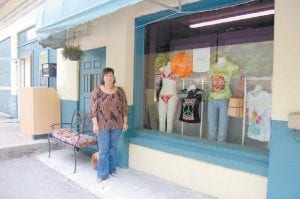 Debbie Campbell, owner of Annie's Frugal Finery, posed for a photo in front of her new location at 31 Hazard Road overlooking the community college.