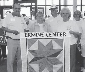 AT THE GAMES — Lennon and Yvonne Hammock carried the banner for th2e Ermine Senior Citizens Center at the Senior Games.