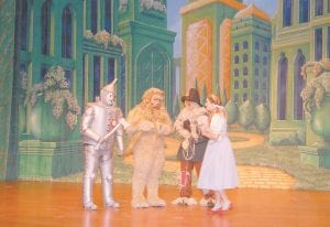 """EMERALD CITY — The Letcher County Central High School drama class will present its production of """"The Wizard of Oz"""" to members of the public on Friday and Saturday nights in the school's auditorium. Admission is $10 and $15. Pictured above in Emerald City are (from left) students Sean Potter (Tin Man), Brandon Jent (Cowardly Lion), Mckenzie Smith (Scarecrow) and Lindsey George (Dorothy). (Photos by Sally Barto)"""