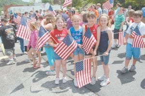School was in session on Memorial Day in the Letcher County School District to make up a day missed because of inclement weather and some classes chose to attend a Memorial Day service at the Letcher County Veterans Memorial Museum. Pictured from left are third-grade students from West Whitesburg Elementary School, Jessica Boggs, Gracie Smith, Kelsey Helle and Hannah Sexton.