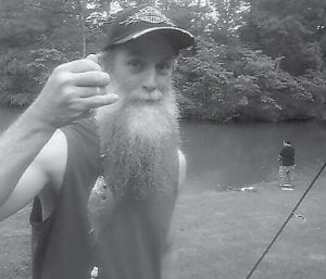 THE CATCH — Greg 'Gabby' Caudill shows one of the many fish, mainly bluegill and crappie, he caught during a weekend trip to a lake in Georgia. He says he will return to the lake with a plan to catch one of the 10-lb. bass that will be there waiting for his return to the private fishing hole.