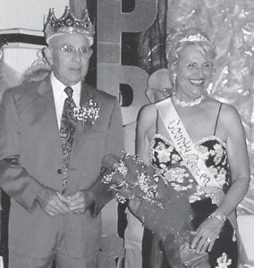 PROM ROYALTY — (Above) Ed Pike was named Letcher County king of the senior citizens prom. Debbie Miranda was chosen as his queen. (Below) Lennon and Yvonne Hammock, the Ermine king and queen, are pictured with (at left) Debbie Slone, site manager of the Ermine Senior Citizens Center.