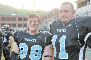 Letcher County Wolves players Reid Mackin, left, and Lenny Bates played in the team's debut Saturday evening. The Wolves fell to the two-time defending Alliance Football League champs, the Knoxville Knights.