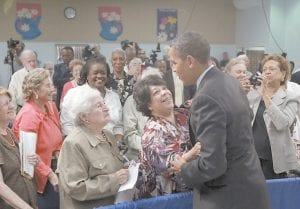 President Barack Obama greeted members of the audience after a town hall meeting on the Affordable Care Act on Tuesday at the Holiday Park Multipurpose Senior Center in Wheaton, Md. (AP Photo)