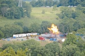 Fire crews from Marshall County battled a gas well fire in Moundsville, W.Va, on Monday. The explosion and resulting fire sent seven people to area hospitals including three workers who were flown to a Pittsburgh burn center. (AP Photo)