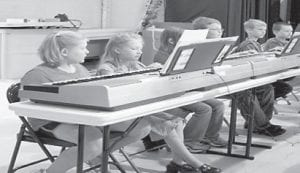 YOUNG MUSICIANS — Arlie Boggs Elementary School's third graders recently performed in a piano recital. Musical selections included 'Marching Up and Down' and 'Mary Had a Little Lamb'. Above are (left to right) Madison Buchanan, Jetta Lewis, Amara Martin, Bret Martin, Jeff rey Craft, and McKinley Hamilton. Below are (left to right) Quinton Boggs, Elijah Estep, Cory Brock, Calista Fields, and Nikki Smith. Also among the performers were Michael Adams, Dylan Anderson, Haley Brown, Sady Holland, Hunter Parsons, Candy Sergent, Shannon Sergent, and Tiff any Sizemore. Amanda Wright directed the recital.