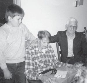 PREACHER BILL HOWARD is pictured with his grandson Chad Brown, who is a father himself now, and a resident of Golden Years Rest Home a long time ago when our church visited there, says Whitesburg correspondent Oma Hatton.
