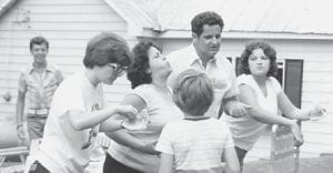 CONTEST — Competing in a watermelon seed spitting contest on a long ago July 4 are Della Pennington, Marshal Tackett and daughter Delores F. Holbrook, Ronnie Pennington's wife and son, and Timothy, son of William Edward.