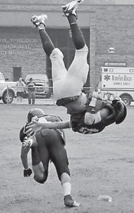 Wolves' defensive back Justin Wallace went airborne for this interception during Letcher County's win over Barbourville, the team's first.