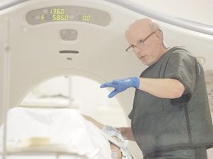 Dr. Steven Birnbaum works a CT scanner with a patient at Southern New Hampshire Medical Center in Nashua, N.H. (AP Photo/)