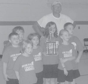 PEE WEE BASKETBALLS — Pictured are members of the Arlie Boggs Elementary School Pee Wee Basketball teams. The Red Bulldogs (above, top photo) are (left to right) Jacob Maggard, Coach Amanda Adams, Shannon Sergent, Candy Sergent, Madison Buchanan, Coach Cortney Adams, Willie Adams, Kaitlyn Lane, Katie Adams, and Hunter Parsons. The Blue Wildcats (above), who took first place in the first ABE Pee Wee Basketball Tourney, are (left to right) Jeremiah Maggard, Leah Sturgill, Jeff rey Craft, Reaghan Spangler, Jordan Osborne, Coach Kenny Spangler, Nikki Smith, Hunter Jackson, and Amelia Spangler. The Green Cougars (pictured below) are Jacob McCown, Coach Randall Sexton, Keeton Sturgill, Megan McCown, Haley Brown, Travis Adams, Hannah Boggs, and Jetta Lewis.