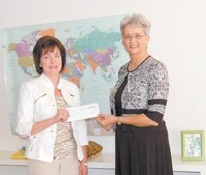 Jennifer Meier presented Marietta Collins, secretary of the Mountain Montessori Preschool Board, with a check for $50,000 on June 22.