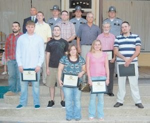 Eleven residents from Letcher, Knott, Leslie, Perry and Breathitt counties were graduated from the second Kentucky State Police Post 13 citizens' police academy on June 15 at the Highlands Winery in Seco. Pictured from left are (front row) Candice Collins, Emily White, (second row) Patrik Hawkins, Stevie Terry, Jordan Gay, John Pack, Joseph Pease, (third row) Jonathan Muncy, Mike Enfusse, Darrell Watts, (fourth row) Det. Lt. Claude Little, Trooper Tony Watts, Trooper Jody Sims and Captain Scott Miller. Not pictured is Angela Napier.