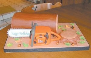 Bonnie Adams created this design for a fondant cake after visiting Breeding's Plumbing and Electric to take photographs of the chainsaws the store sells.