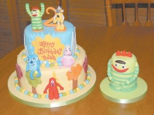 """This colorful, two-tiered cake is based on Nickelodeon's hit television show, """"Yo Gabba Gabba."""" Bonnie Adams made the characters from rolled fondant. (Photo by Sally Barto)"""