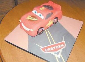 "Adams enjoys decorating this cake based on the popular Disney/Pixar movie, ""Cars,"" featuring Lightning McQueen."