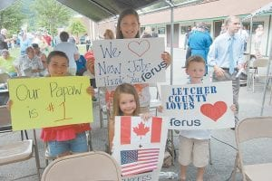 ECONOMIC DEVELOPMENT FANS — Amelia Wilson, Abigale Wilson, Kade Minton and Maggie Minton held signs in support of their grandfather, Joe DePriest, who is the director of Letcher County Economic Development. DePriest spoke at a groundbreaking ceremony for Ferus Corp. at Jenkins City Park on June 23. DePriest is president of the Letcher County Chamber of Commerce and his wife, Brenda, is secretary and treasurer.