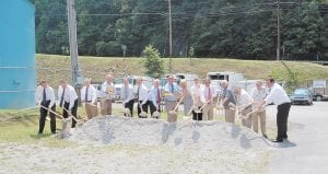 A groundbreaking ceremony was held June 23 at Jenkins City Park to welcome Canadian-based Ferus Corp. to Gateway Industrial Park. Pictured from left are Jenkins Mayor D. Charles Dixon, Ferus Corp. Vice President Chad Porter, Letcher County Economic Development Director Joe De- Priest, State Sen. Johnny Ray Turner, Ferus Corp. Vice President External Affairs and Treasurer Joe Ladouceur, Ferus Corp. President and CEO Richard Brown, Gov. Steven L. Beshear, Letcher County Judge/Executive Jim Ward, State Rep. Leslie Combs, Magistrate Codell Gibson, Magistrate Archie Banks, Magistrate Wayne Fleming, Jenkins City Council Member Terry Braddock, Magistrate Bob Lewis and Julian R. Slone with the Appalachian Industrial Authority.