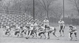 """1953-54 Whitesburg High School Football Team The starting 11 of 1953 were: B. Holbrook, quarterback (#13); Buddy Fields, right halfback (#18); Bobby Kincer, left halfback (#14); Jimmy Enlow, fullback (#32); Richard Adams, right end (#16); F. C. Hammonds, right tackle (#39); Don Caudill, right guard (#10); Garland Stallard, center (#21); Bobby Adams, left guard (#25); William """"Trim"""" Richardson, left tackle (#38); Ralph Ogelive, left end (#17)."""