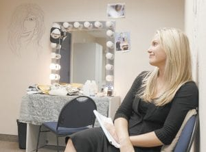 """Cast member Terri Colombino reminisced in her dressing room during the final weeks of taping for CBS's soap opera """"As the World Turns,"""" at JC Studios in New York. The final episode of the soap opera, which has been running since 1956, will air on Sept. 17. (AP Photo)"""