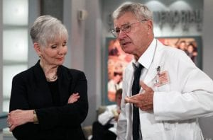 """Kathryn Hays, left, watched colleague Don Hastings cross his fingers during the taping of an episode of """"As the World Turns,"""" at JC Studios in New York. (AP Photo)"""