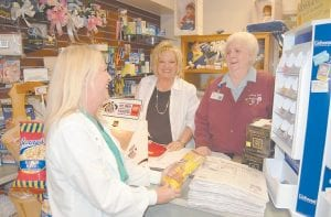 WARH AUXILIARY GIFT SHOP — Patsy Bowen (pictured at right) laughed as Belinda Sexton, a registered nurse, bought a snack at the gift shop. Also pictured is Jennifer Richardson, the hospital gift shop manager.