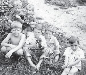 """THE BOYS — Pictured are (back row) Billy Hatton, Larry Hatton, (front row) Coach Hillard Howard, Robert Hatton, Astor 'Red' Hatton, and """"your old carpet man"""" Charles Howard, according to Whitesburg correspondent Oma Hatton. """"Don't let this picture fool you,"""" she said, """"they are all senior citizens and grandfathers. They didn't have enough puppies for everyone. They just look young."""""""