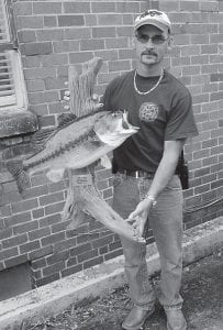 BIG CATCH — Tim Lucas, of Sandlick recently caught a largemouth bass weighing 10 lbs., three ounces at Fishpond Lake.