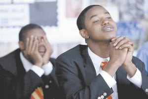 High school seniors participate in an English class in Chicago. Researchers say giving teens 30 extra minutes to start their school day leads to more alertness in class, better moods, less tardiness, and even healthier breakfasts. (AP Photo)