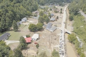 Gov. Steve Beshear toured the flood-damaged community of Raccoon in Pike County as thousands remained without electricity or running water this week. (AP Photo/The Herald-Leader, Charles Bertram)