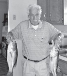 FISHERMAN — Rhuford Hart displays the bass he caught in western Kentucky.