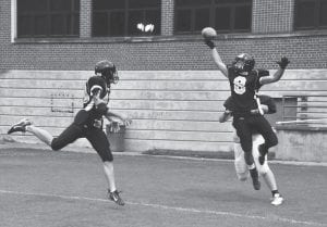"""WOLVES ROUTE BARBOURVILLE — Former Letcher County high school football standouts Johnathan Tucker and Chris Puckett teamed up to disrupt a """"hail Mary"""" pass in the Wolves' 30-12 win over Barbourville in a semi-pro game on Saturday. Tucker, left, is a former Letcher Central Cougar, while Puckett wore the green and white of the Jenkins Cavaliers. (Photo by Chris Anderson)"""
