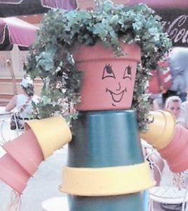 Connie Fields took these photographs recently at Dollywood of this zebra and person made out of flowerpots, rope and paint. Fields and the rest of the committee are encouraging Letcher County residents to make similar flowerpot art to be displayed throughout the county during the Mountain Heritage Festival.