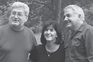 """REUNION — John Howard, Joanne (Howard) Brown, and Bobby Ray Howard are pictured at a Howard reunion. Whitesburg correspondent Oma Hatton says, """"Benny Dent asked about you, John."""""""