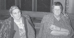 """SISTERS — Pictured are the late Cindy Howard and Polly Howard, who were sisters, at Cowan Community Center on Christmas of 1991. Whitesburg correspondent Oma Hatton says, """"They were two of the best. They married brothers, my dad Bill Howard and Leslie Howard. This was Cindy's birthday."""""""