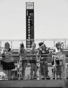 Fans gathered on the top of the stands overlooking the garage area during practice for the NASCAR Brickyard 400 auto race at the Indianapolis Motor Speedway in Indianapolis on July 24. Any sports event that draws an estimated crowd of 180,000 has to be considered a smashing success. Except when it drew 270,000 two years earlier. There were empty seats at Sunday's Brickyard 400, leading some to wonder whether one of NASCAR's marquee events has lost a little bit of its luster. (AP Photo)