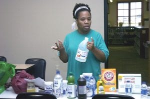 Jackie Garrison says vinegar can be used as a household cleaner and in the wash. Garrison has led workshops to teach how to make laundry detergent and other household products. She also has her own line of organic and handmade lotions, bath salts, air fresheners and more. (AP Photo/the Town Talk, Melinda Martinez)
