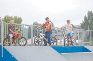 YOUNG COMPETITORS — Keaston Craft, Vincent Fleming and Jacob Boggs waited for the Letcher County Skate Off and BMX Competition to begin at the Letcher County Skate Park on July 31.
