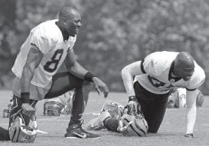 Cincinnati Bengals wide receiver Chad Ochocinco, right, enjoyed a laugh with wide receiver Terrell Owens during practice Tuesday at the NFL football team's training camp in Georgetown. (AP Photo/Al Behrman)