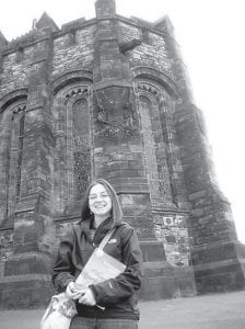 Amanda Fickey poses in front of the Edinburgh Castle.