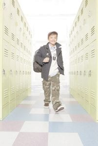 Camo has been growing in popularity for kids over the past few years, and that only increases as designers and manufacturers develop new color combinations — for boys and girls — and find new trendy places to put it, such as pant cuff s and bag straps. (AP Photo/The Children's Place)