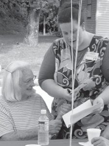 BLOCK PARTY — Thelma Brown (seated) and Gretta Fields of Letcher Manor Nursing and Rehabilitation, enjoyed a block party hosted by Letcher Manor July 28 for residents at the Whitesburg Housing Authority. Entertainment was provided by the Carolina Baptist Association from Loris, S.C.